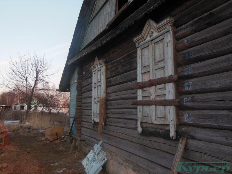 Дом с забитыми ставнями